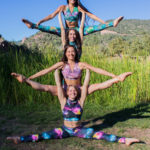 Paulina Milligan with friends doing acro-yoga. Photo by Nathan Machutta