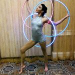 Paulina posing before her hula hoop act with House of Cirque.