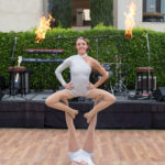 Female Fire Acro Duo at Mountain Shadows booked through Jessica Packard Entertainment. Photo by Twin Lens photography