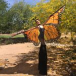Paulina Milligan stilt walking as a butterfly character for Jessica Packard Entertainment
